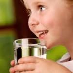school children drinking water